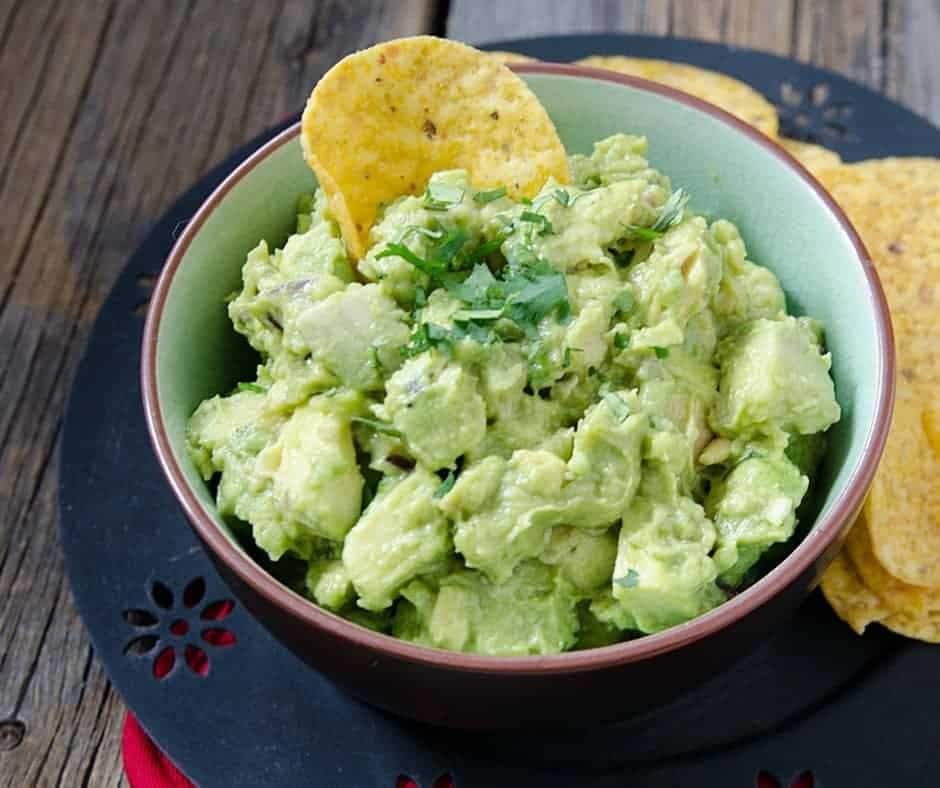Homemade Guacamole is an easy to make recipe that is low in points and packed with added nutritional value. Fruit, veggie, who cares! Avocados are delicious