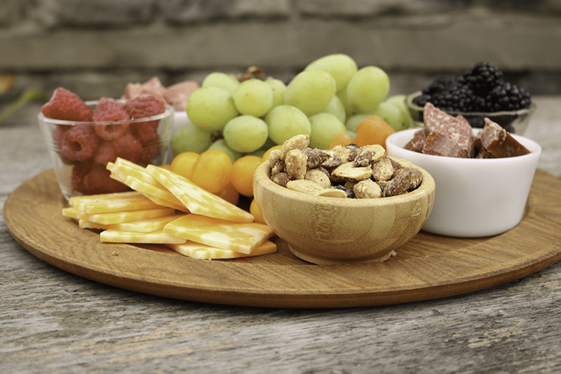Put together an appetizer board to make your holiday entertaining easy! Pair Sahale Snacks with cheese, fruit and cold cuts for a platter guests will love. #changesnackingforgood #CollectiveBias