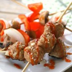 One serving of three Weight Watchers Sweet and Sour Meatballs on a skewer.