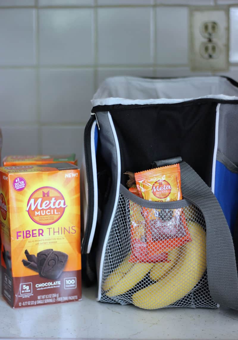 Since I try as hard as possible to make healthy choices, I pack my own water and snacks, whenever possible to ensure I have healthy snacks for traveling. I always have a small insulated bag with cut up fruit, string cheese, and hard-boiled eggs. In the side pockets is where I keep my beef jerky and individually wrapped packs of Metamucil Fiber Thins.
