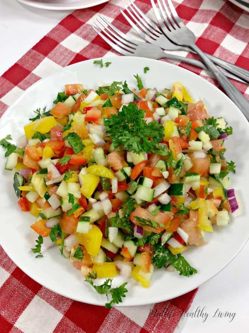 This Weight Watchers Mediterranean salad is light and delicious. It's a great summer side dish. It's healthy too, just 1 Freestyle Smart Point per serving!