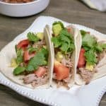 Need a quick and easy weeknight meal that can feed a crowd? These slow cooker pork tacos are a great family dinner recipe. The Crockpot does all the hard work, taco night has never tasted so good!