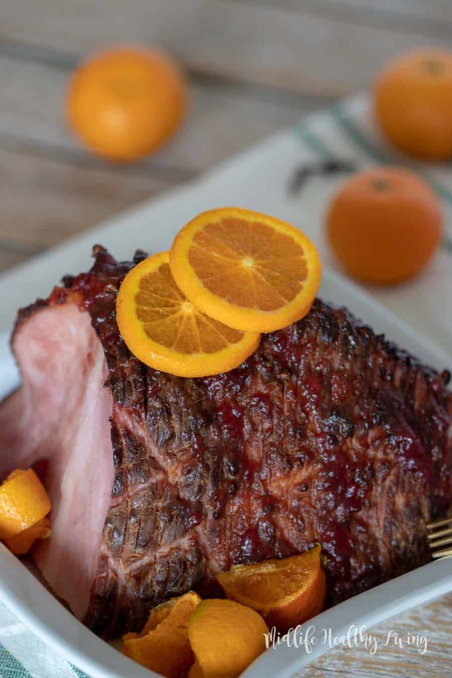 This Weight Watchers citrus and cranberry ham is a snap to make.  There are 5 Weight Watchers Freestyle Smart Points in each serving of this delicious ham.