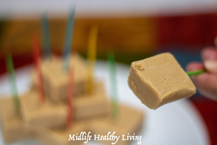 A close up on a single piece of 2 ingredient peanut butter fudge ready to eat.