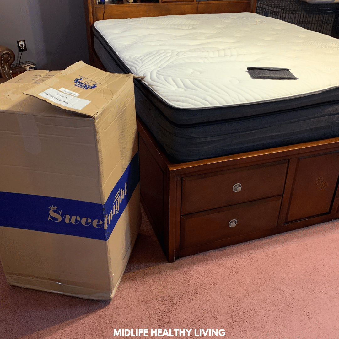 Sweetnight mattress on the bed and the box it came in.