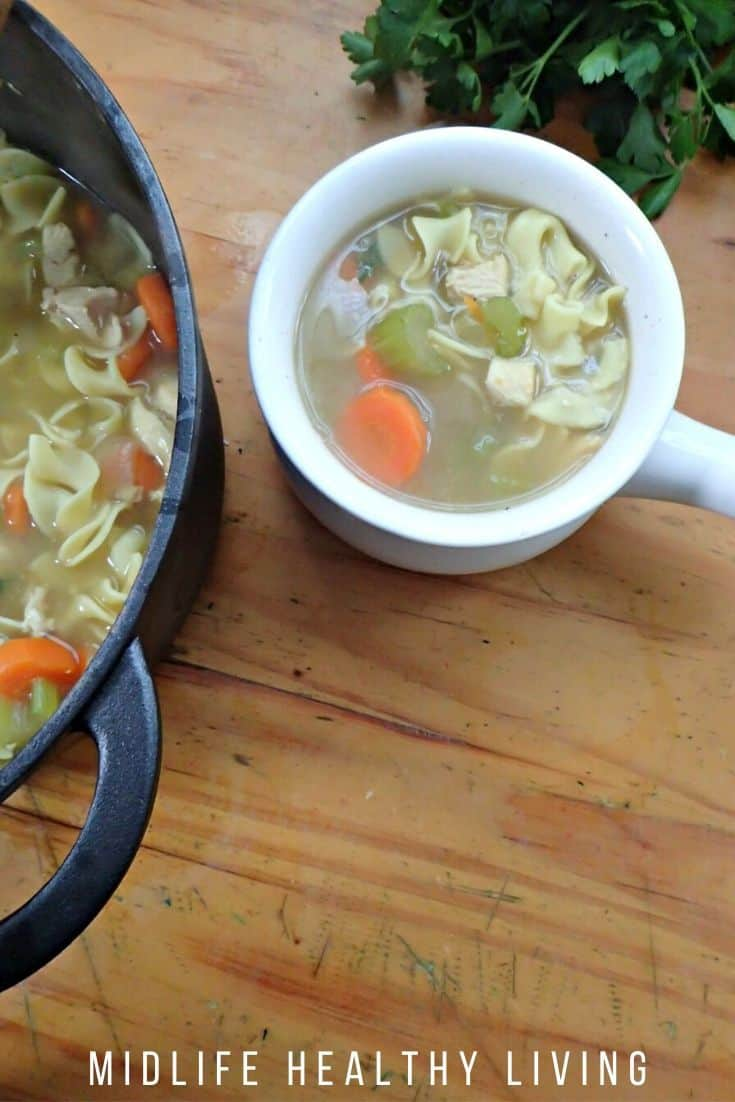 A shot of a bowl of the finished chicken noodle soup.