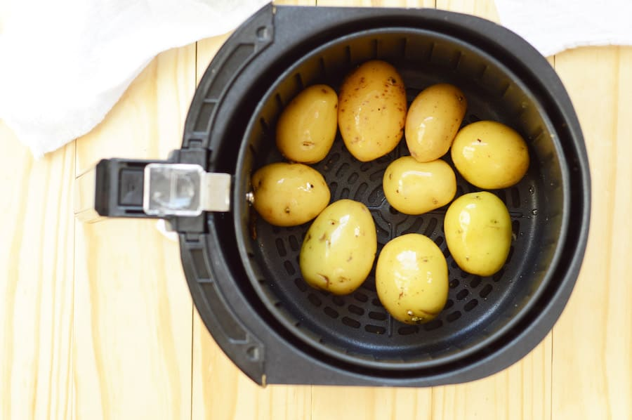 A view into the air fryer as the potatoes are cooking.