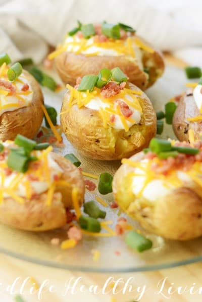Featured image showing the finished and topped air fryer loaded baked potatoes.