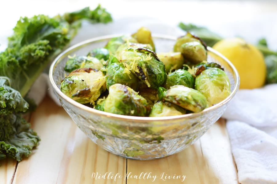 A bowl full of the finished air fryer Brussels sprouts