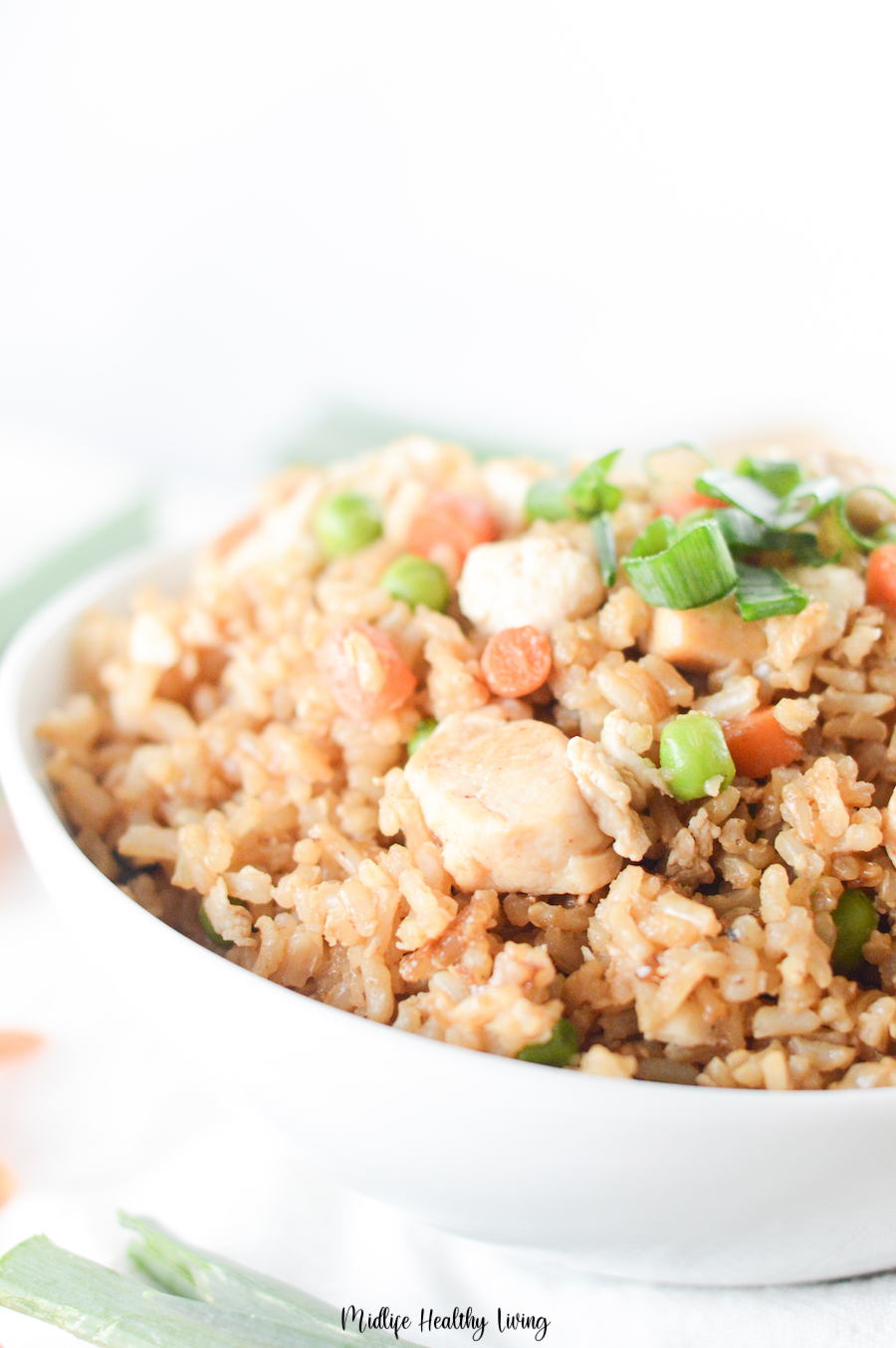 A close up of the finished result of how to make chicken fried rice.