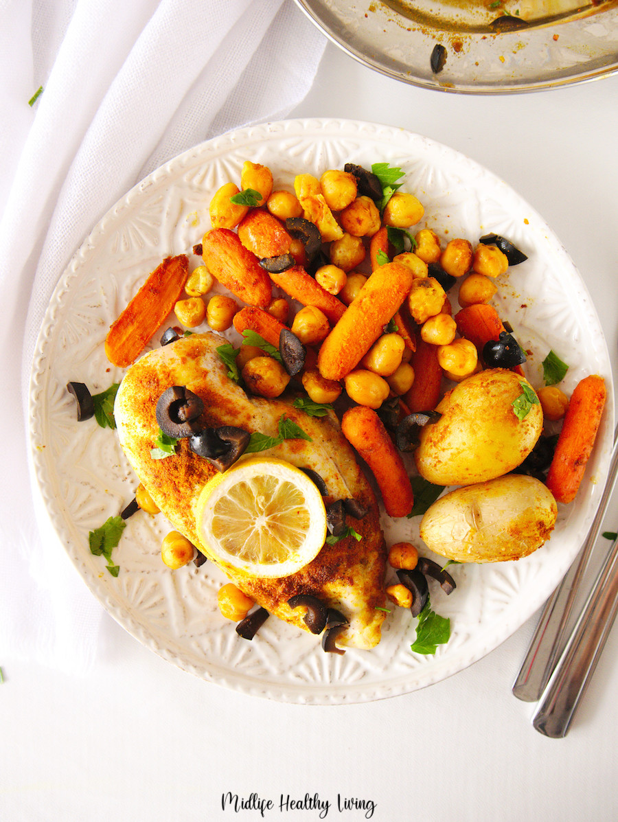 A top down look at a plate full of weight watchers chicken sheet pan dinner.
