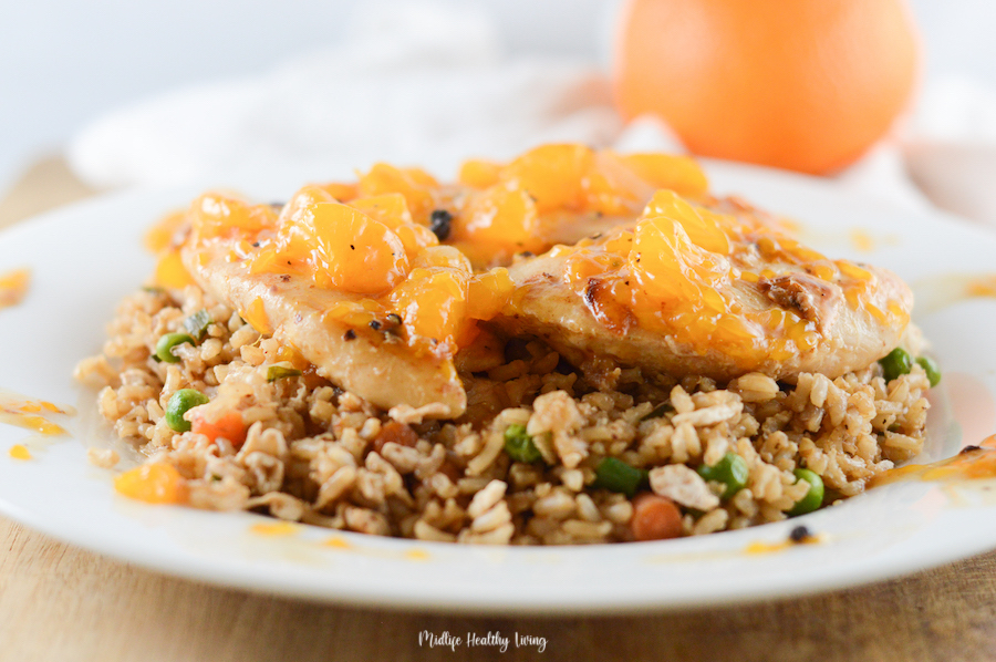 Featured Image showing the finished orange chicken on a plate with rice ready to eat.