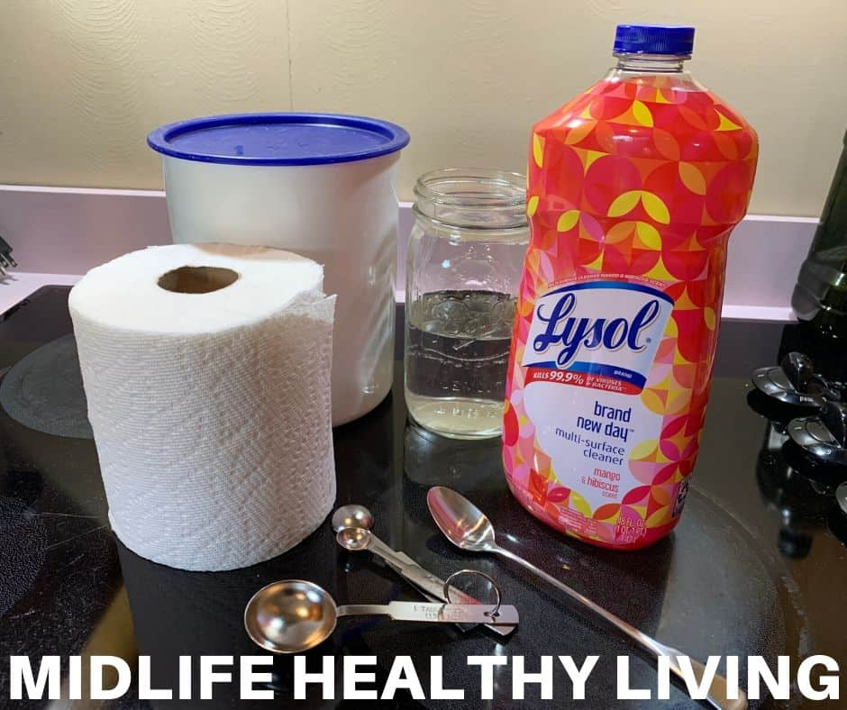A picture showing the ingredients for DIY disinfecting wipes with Lysol cleaner.