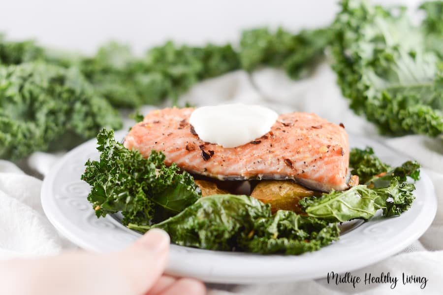 Another image showing the finished recipe for salmon potatoes and kale in a dish ready to eat.