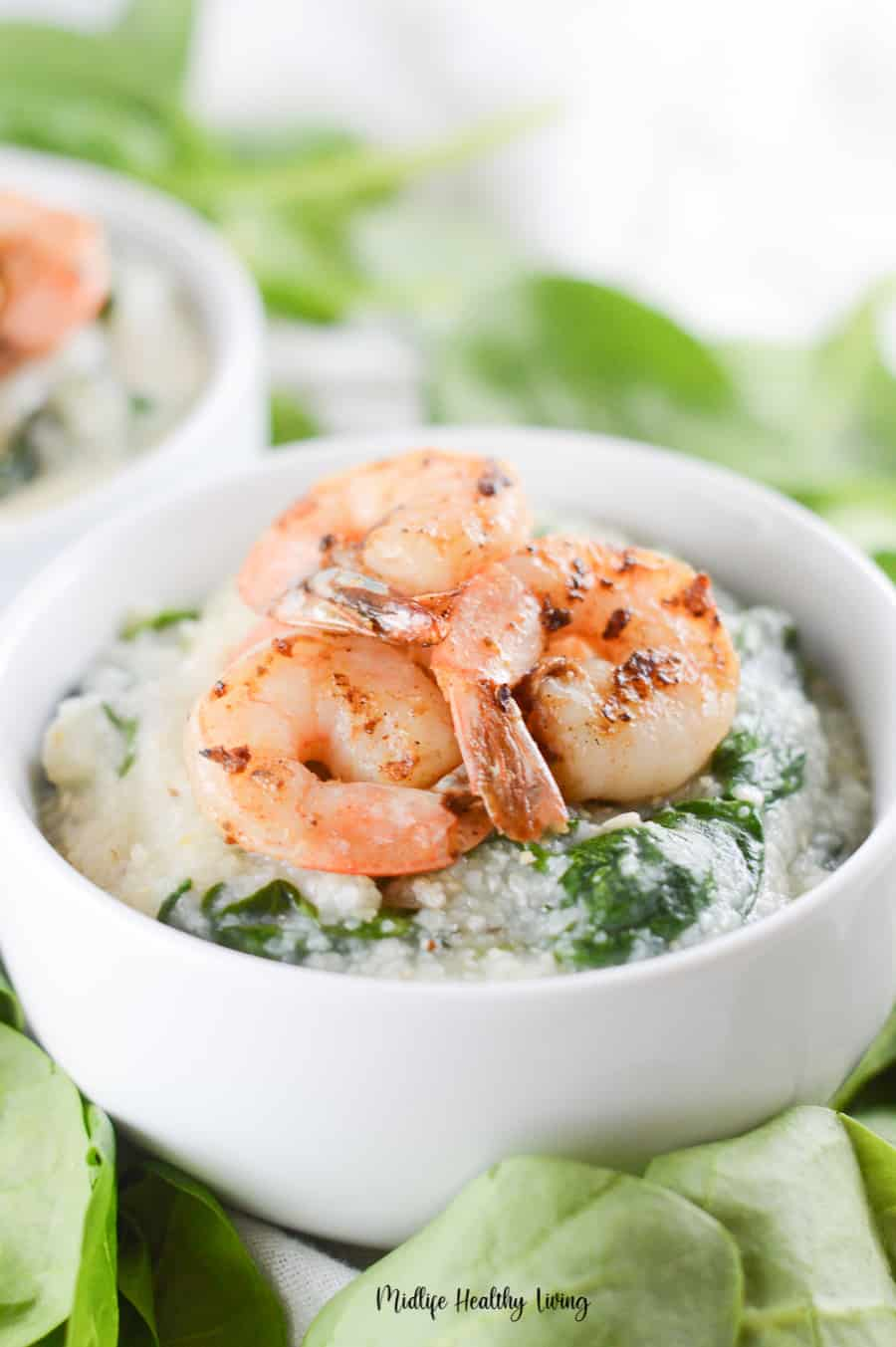 A close up shot of a bowl full of weight watchers grits with shrimp on top!