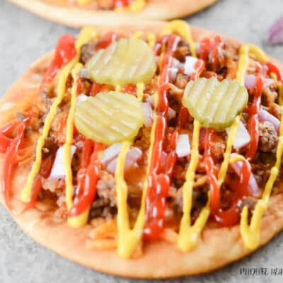 This featured image shows a single bacon cheeseburger flatbread pizza ready to eat!
