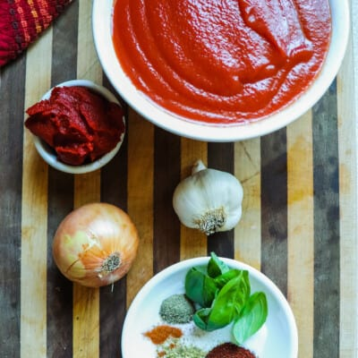 Here we have a featured image that shows the sauce ingredients for weight watchers spaghetti sauce recipe all laid out and ready to begin.