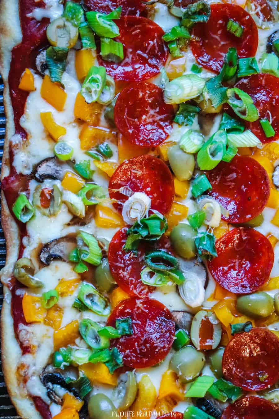 A top down look at a full sheet of pizza ready to be enjoyed.