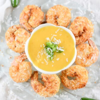 Featured image showing the finished weight watchers coconut shrimp arranged around some dipping sauce!