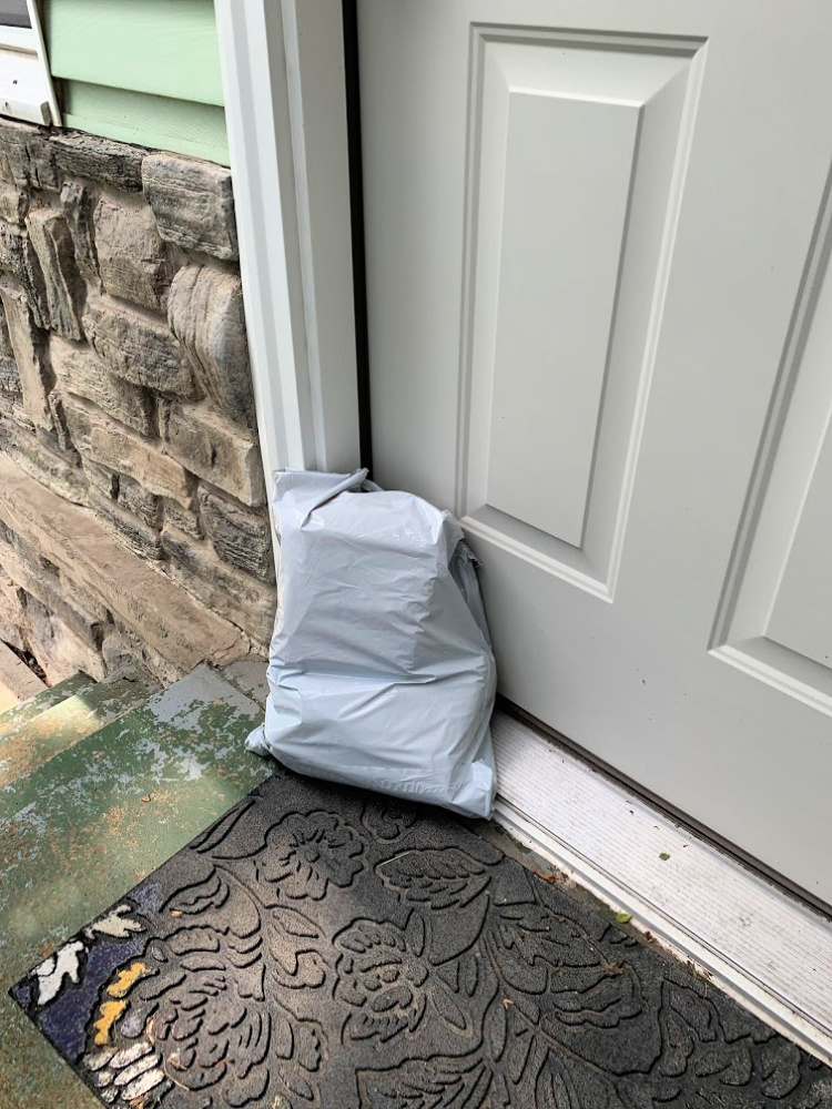 Generic package sitting by front door.