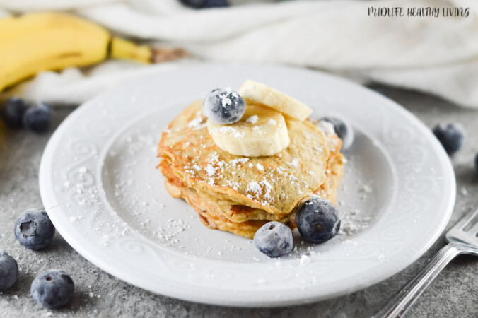 Featured image showing the finished banana pancakes for Weight Watches with toppings ready to be enjoyed.