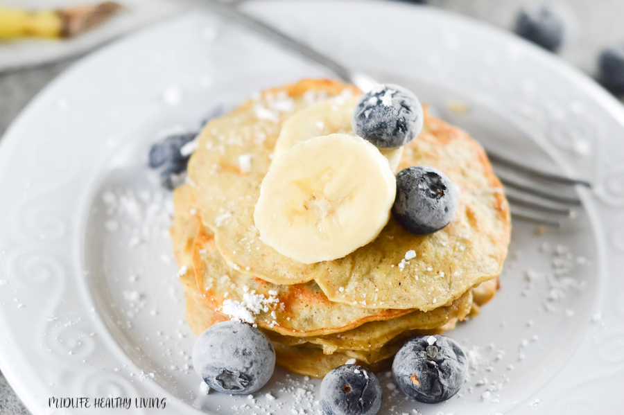 Featured image showing the finished banana pancakes for WW with blueberries on top ready to eat.