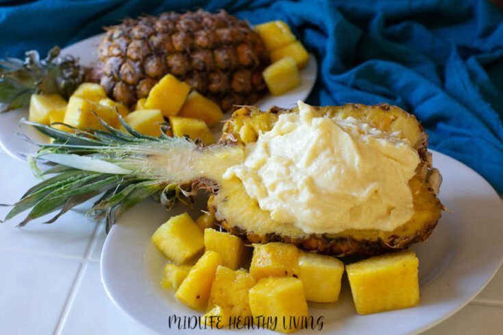 weight watchers dole whip recipe served in a hollowed out pineapple half.