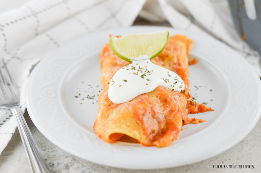 Featured image showing the finished weight watchers beef enchiladas ready to eat.