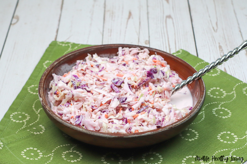 Another look at a bowl full of the finished recipe for coleslaw ready to serve.