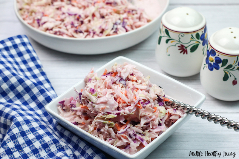 Finished recipe for coleslaw in a bowl ready to eat.