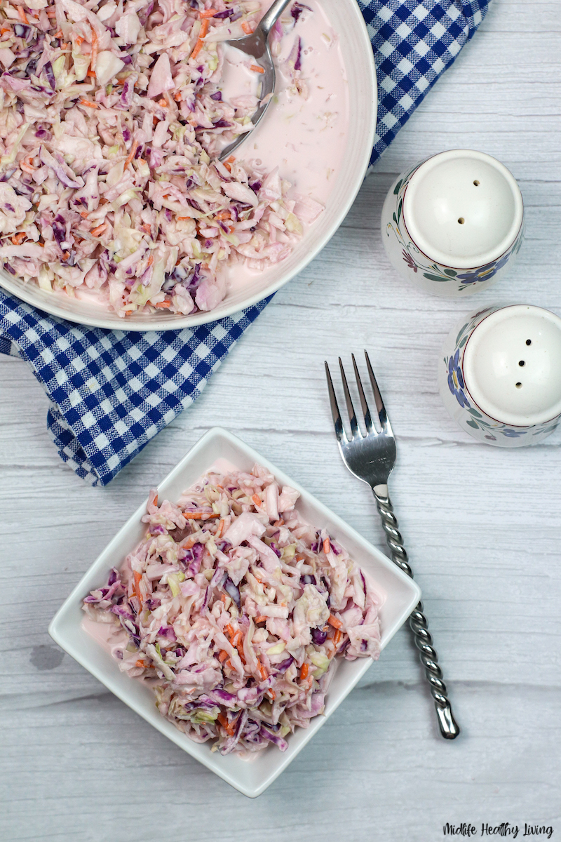 A top down look at a bowl full of the finished coleslaw ready to serve and eat.