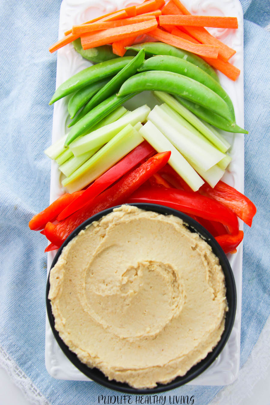 A top down look at the weight watchers hummus served with veggies ready to eat.
