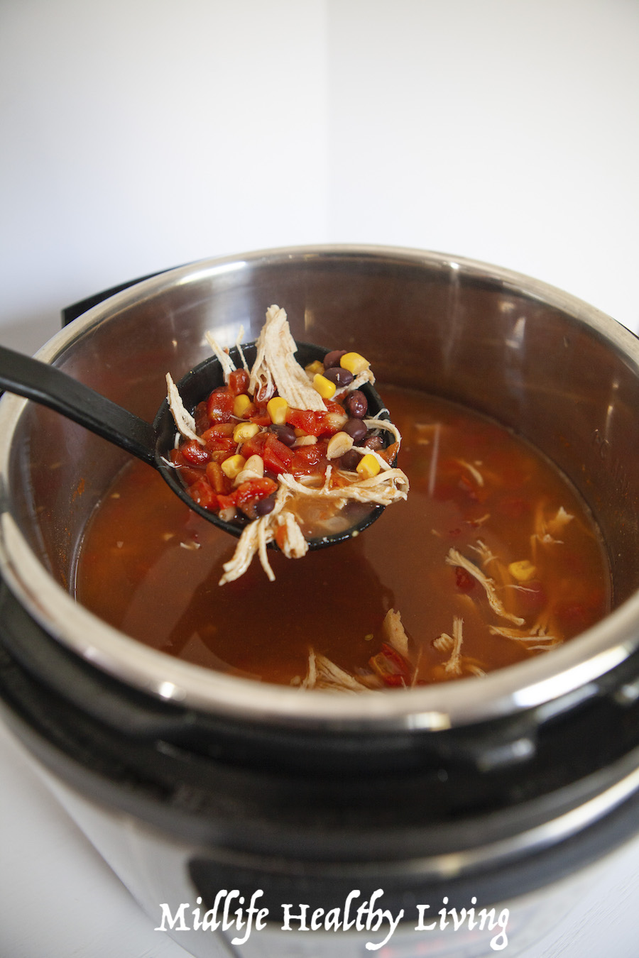 A look into the instant pot at the finished chili recipe ready to serve.