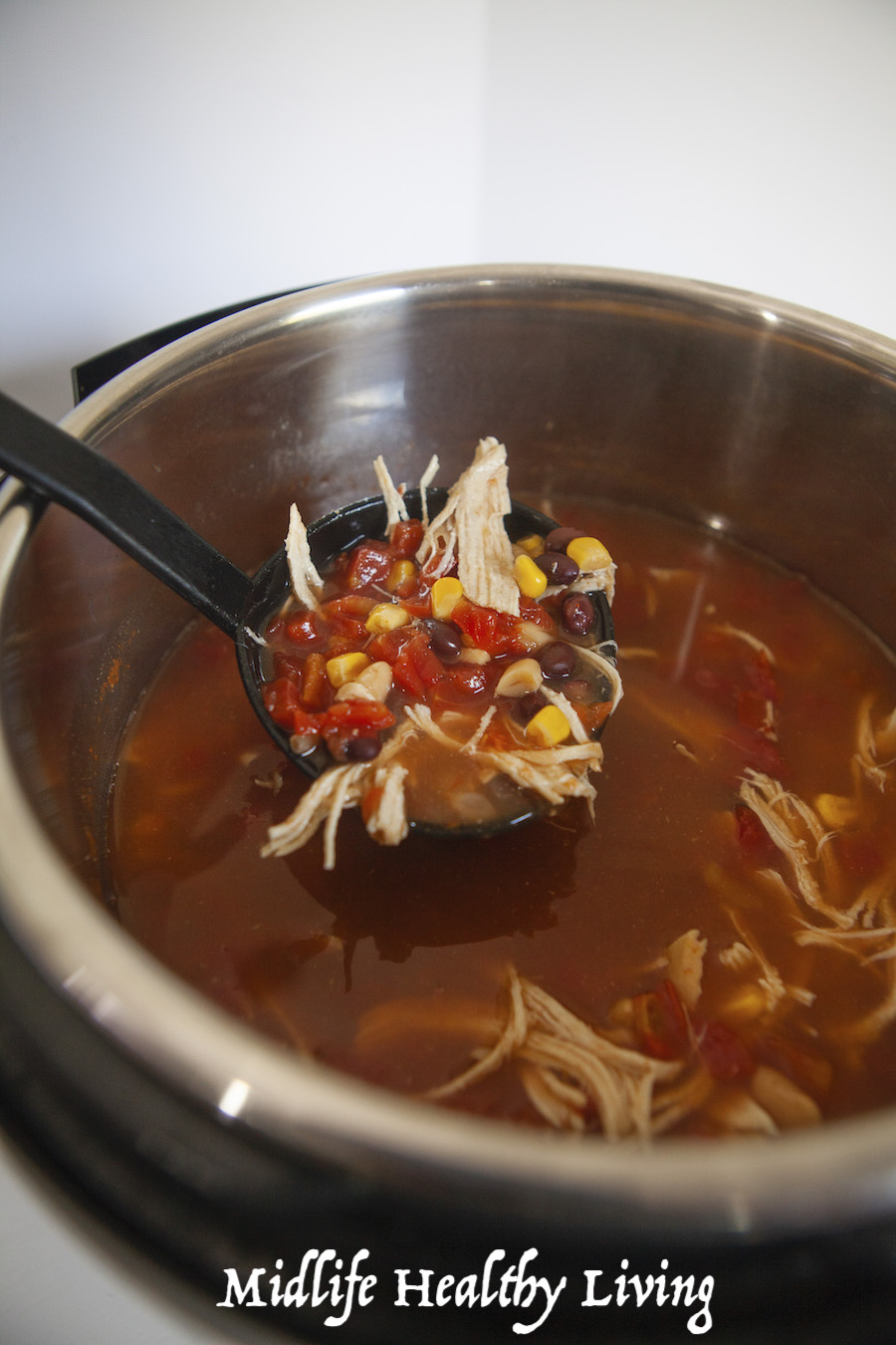 A scoop of the finished Weight Watchers chicken chili ready to be served and eaten.