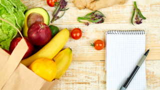 shopping list with grocery bag nearby