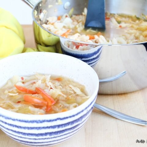 Featured image showing the finished WW cabbage soup in a bowl ready to eat with spoon on the side.