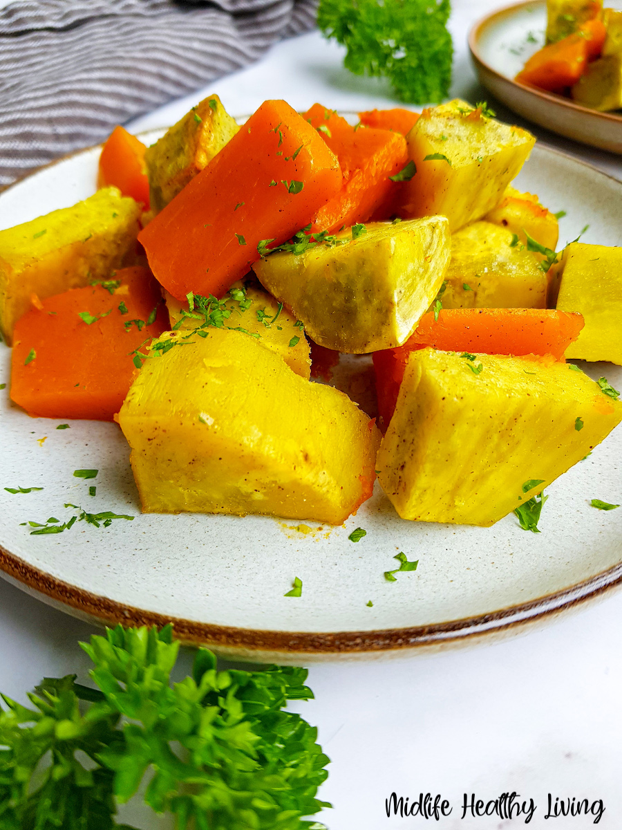 A plate full of the finished roasted sweet potatoes and squash ready to eat.