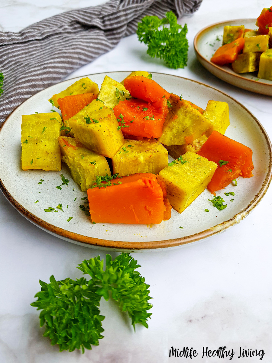 A serving plate full of the finished sweet potatoes ready to eat.