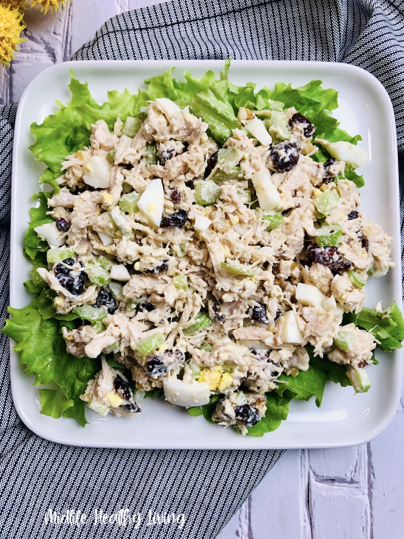 A plate full of finished chicken salad ready to serve.