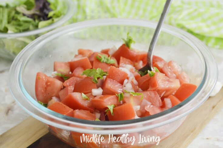 featured image showing the finished weight watchers tomato salad ready to eat.