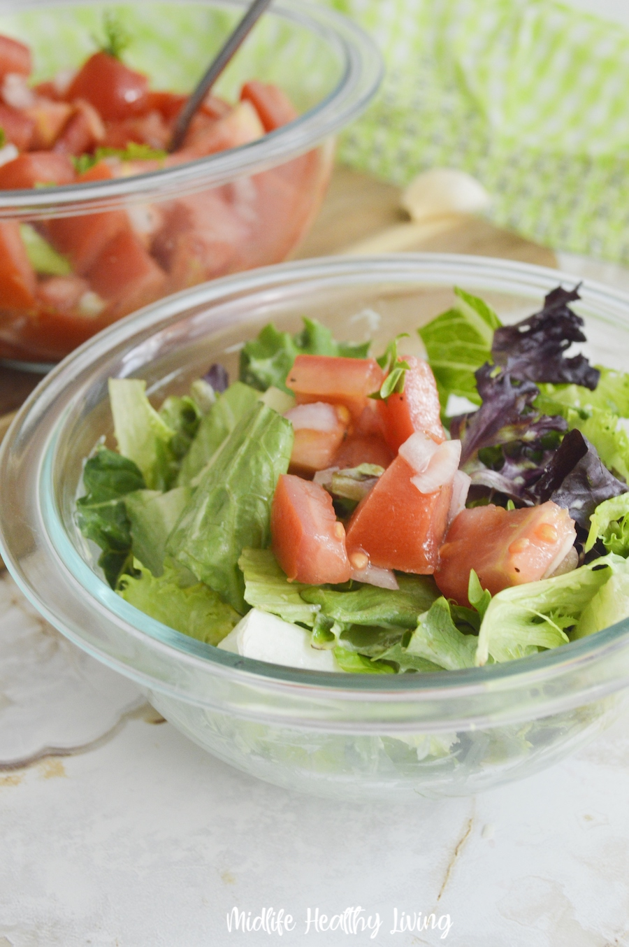 Tomato salad served over lettuce for a delicious lunch.