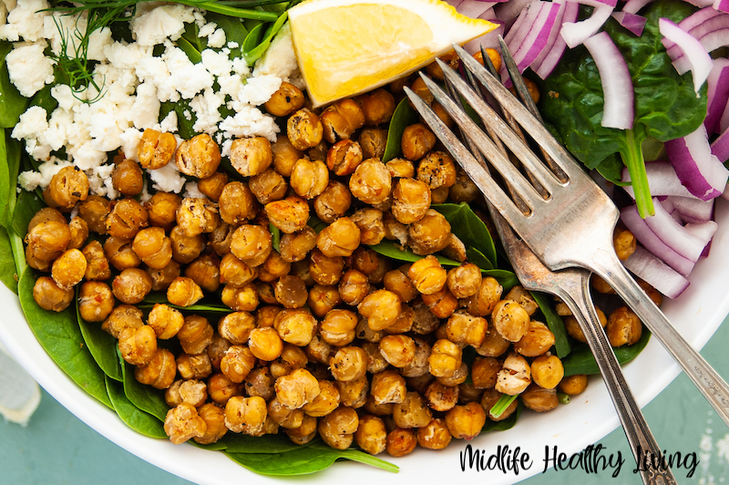 The ww roasted chickpeas on a salad ready to eat.