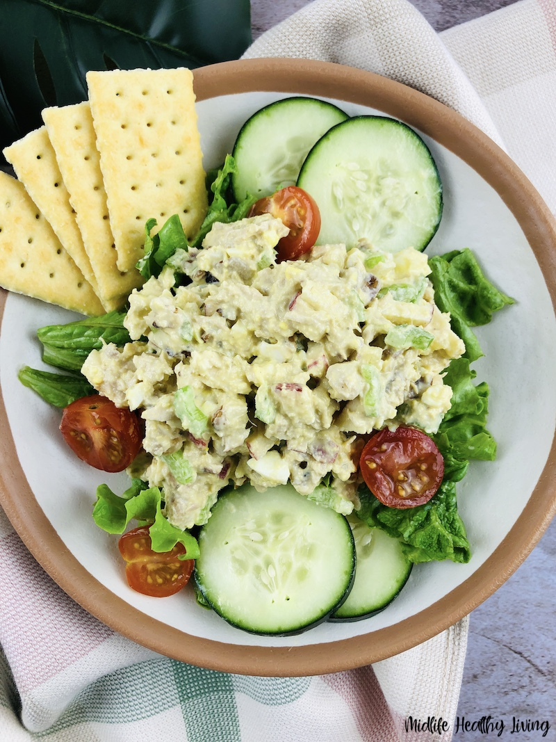 A salad with weight watchers tuna salad on top with crackers as well.