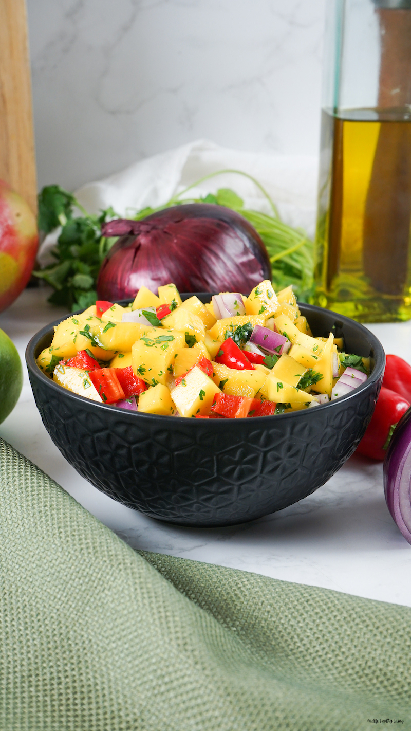 a bowl of the weight watchers mango salsa ready to eat.