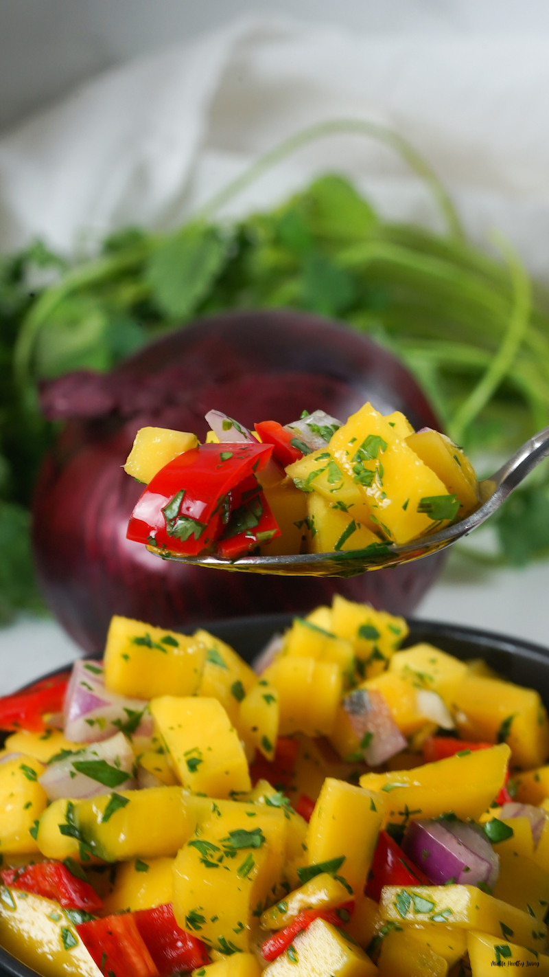 a scoop of the weight watchers mango salsa ready to eat.