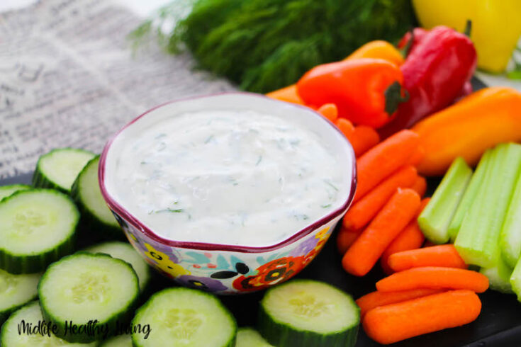 A bowl full of the finished dill dip for weight watchers.
