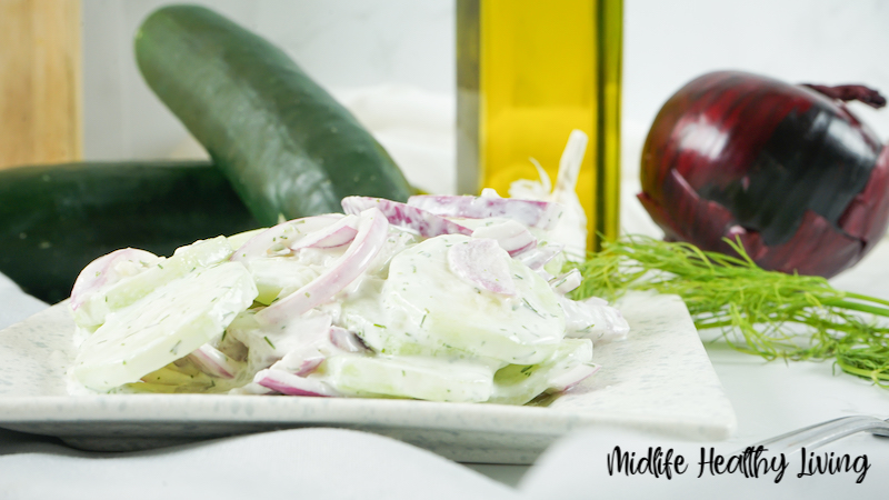 A side view of a plate with a serving of the finished weight watchers cucumber salad on it ready to be enjoyed.