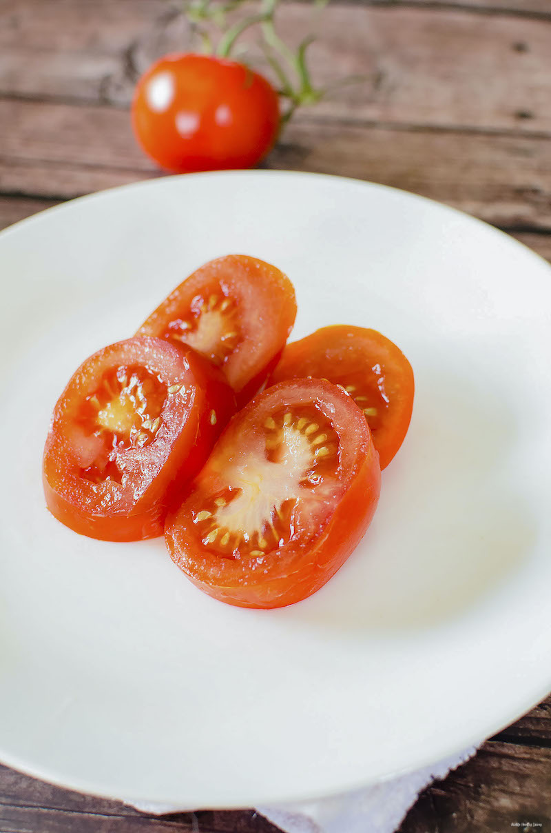 tomato sliced and plated ready for topping.