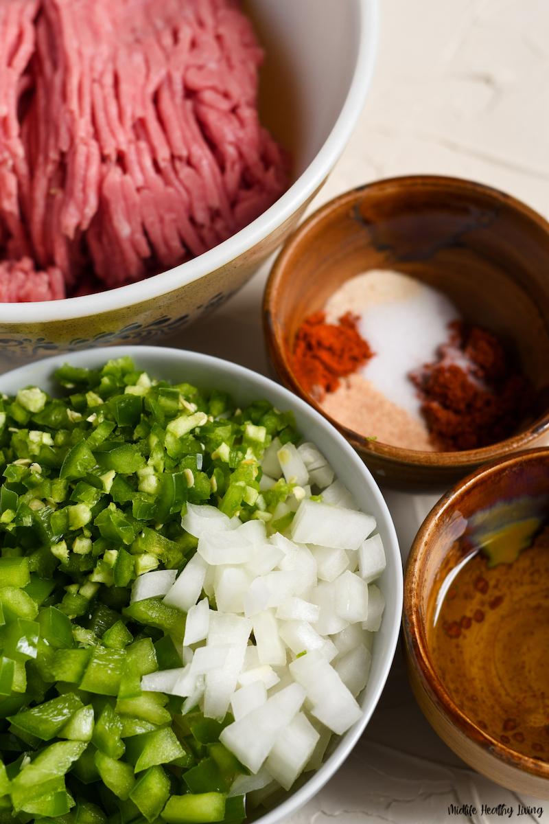 Ingredients to making ground turkey burritos for weight watchers.